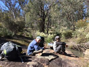 Teen trek boys on rocks Piesse Valley