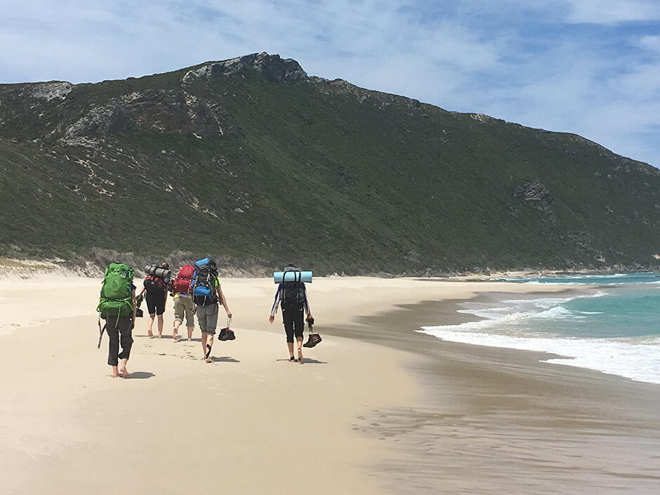 Teen treks girls on Peaceful Bay beach