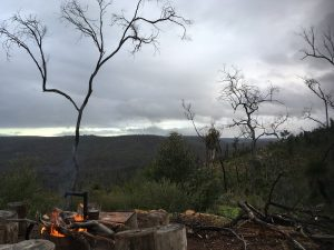 Overnight hikes campfire with view from Helena Hut